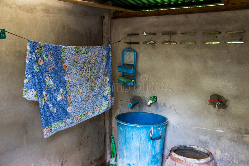 Old rustic bathroom. Backgruond toilet royalty free stock image