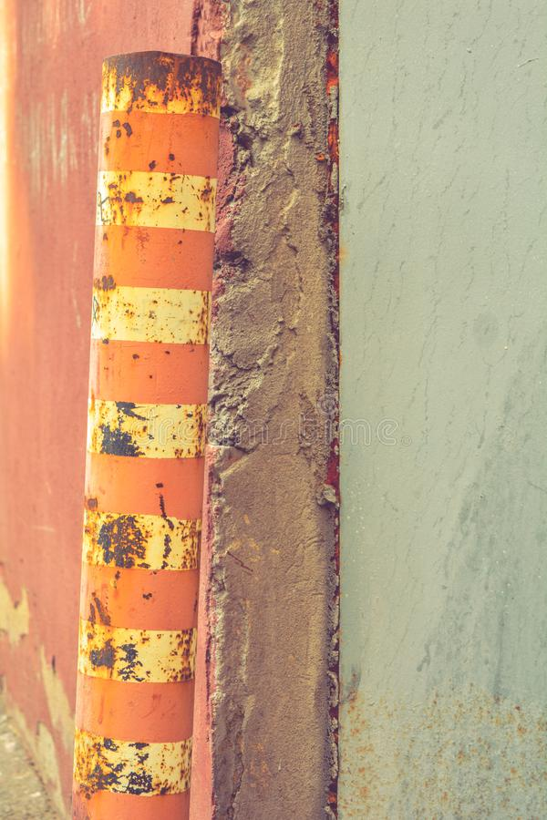 Old rustic Bollard or Traffic pole. Sign for cars with white and red stripes stock image