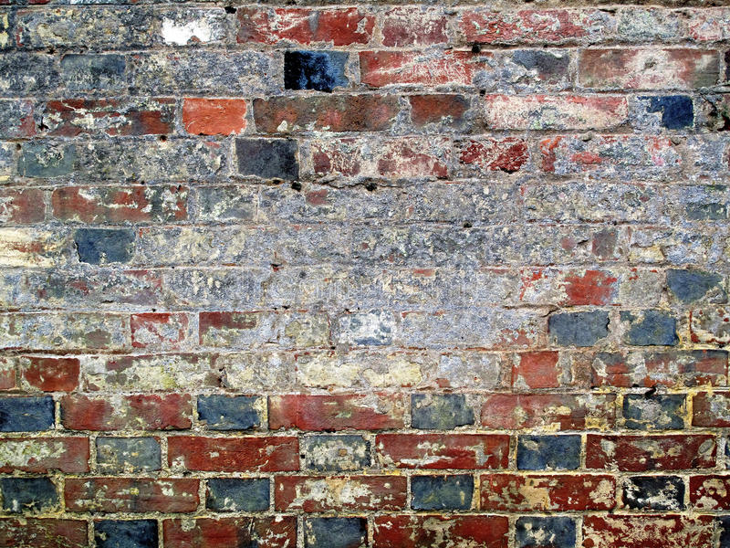 Old Rustic Brick Wall. An old weathered rustic brick wall stock image