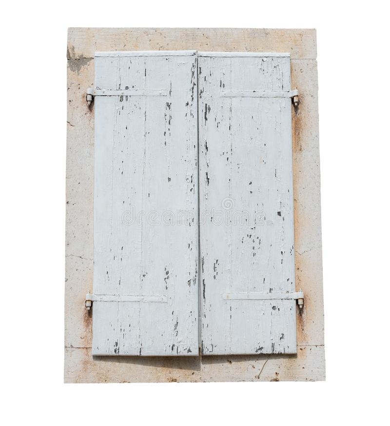 Old rustic closed white wooden window shutters isolated on white background stock photo