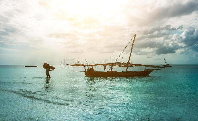 Rustic fishing boat sitting in ocean, zanzibar royalty free stock photos