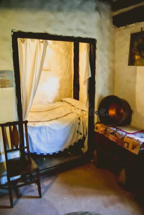 Old rustic house bedroom stock image