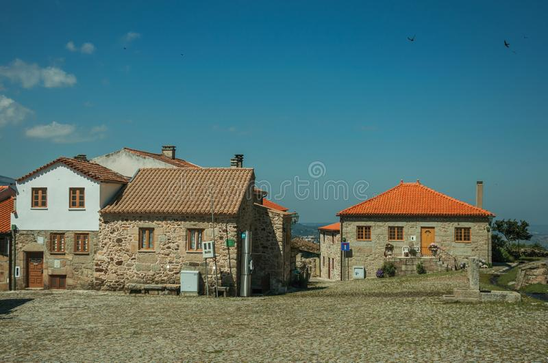 Old rustic houses made of stone in front of square stock image