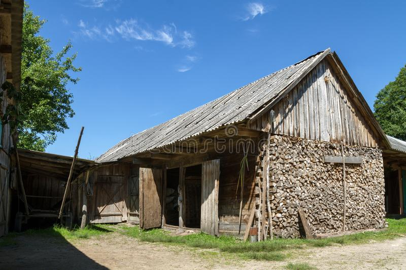 Old rustic wooden barn building in village at summer. Old rustic wooden barn building in village royalty free stock photo
