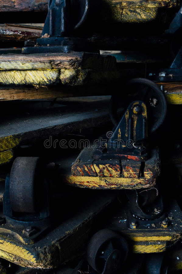 Old Industrial Wheels and Pallets - Abandoned Textile Mill royalty free stock image