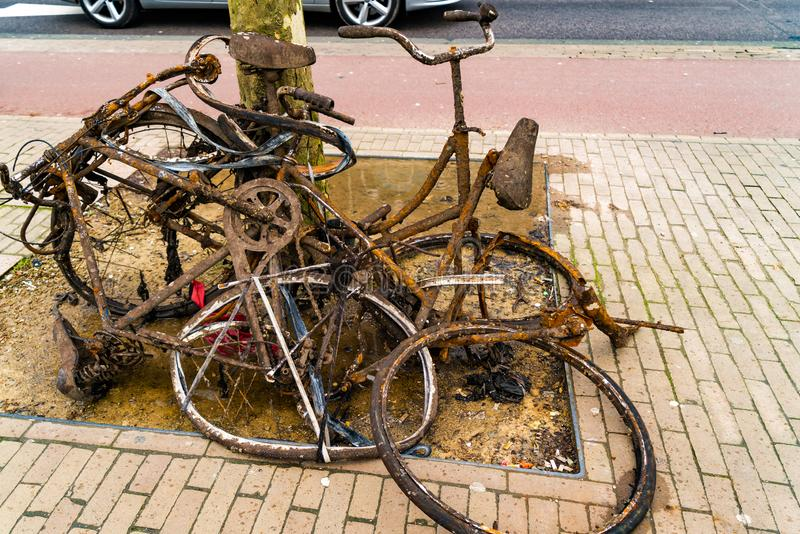 Old rusty abandoned bikes royalty free stock photo