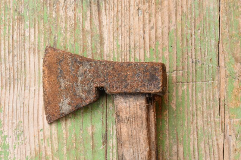 Old, rusty ax with a wooden handle stock photo