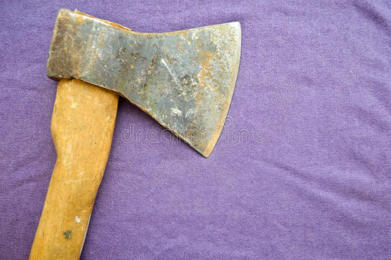 Old, rusty ax with a wooden handle stock images