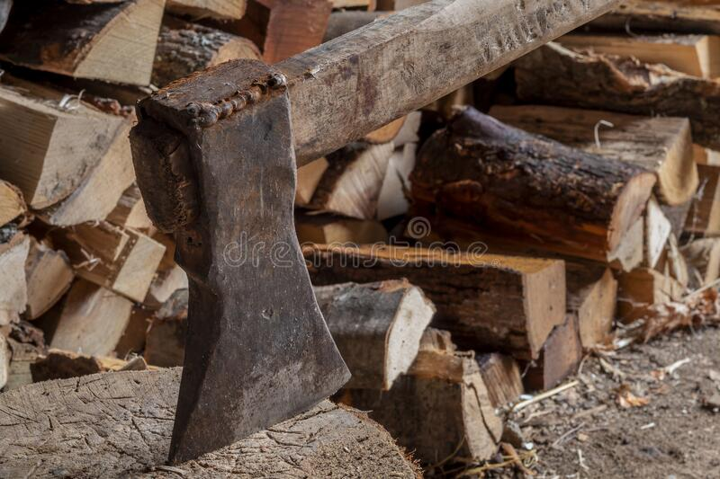 Old Rusty Ax on Wooden Logs. Image of Old Rusty Ax on Wooden Logs royalty free stock images