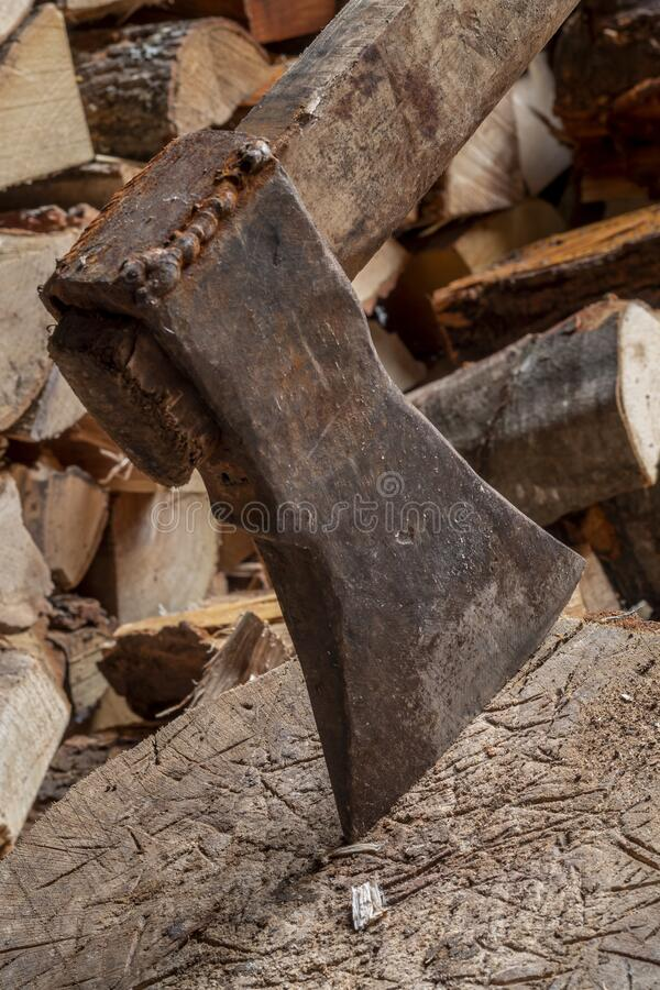 Old Rusty Ax on Wooden Logs. Image of Old Rusty Ax on Wooden Logs stock images