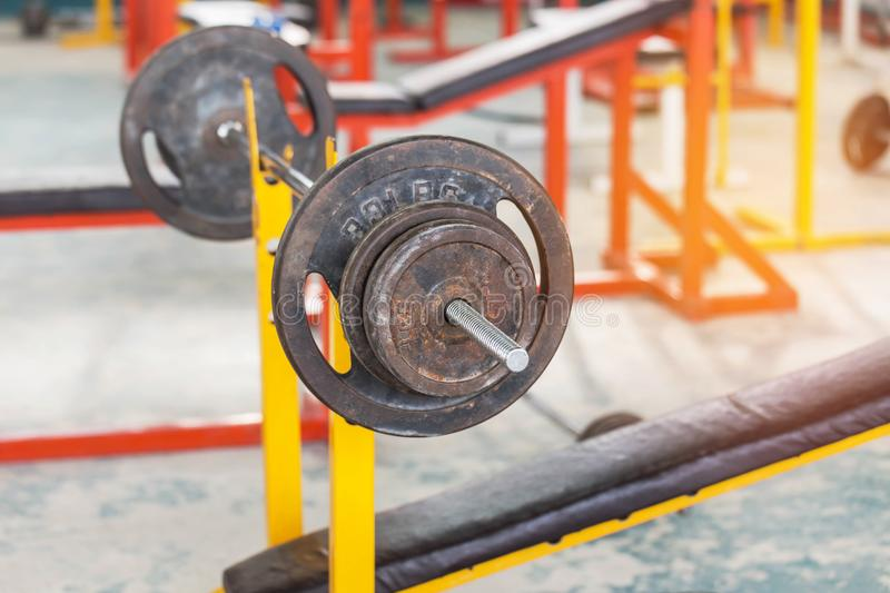 Old rusty barbells weight equipment sports training and exercises for bodybuilding in fitness room. Old rusty barbells weight equipment sports training and royalty free stock photography