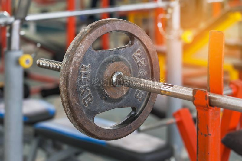 Old rusty barbells weight equipment sports training and exercises for bodybuilding in fitness room. Old rusty barbells weight equipment sports training and royalty free stock image