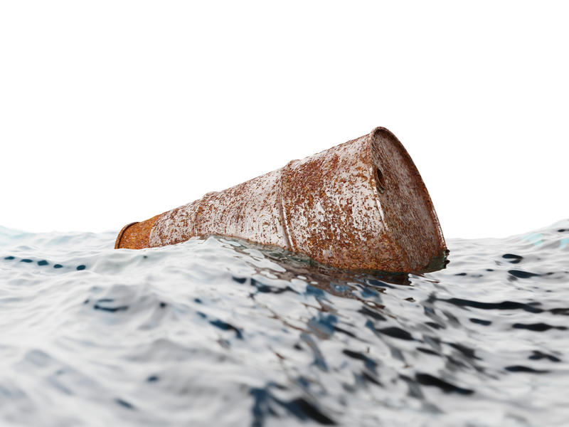 Old rusty barrel floating on the waves royalty free stock image