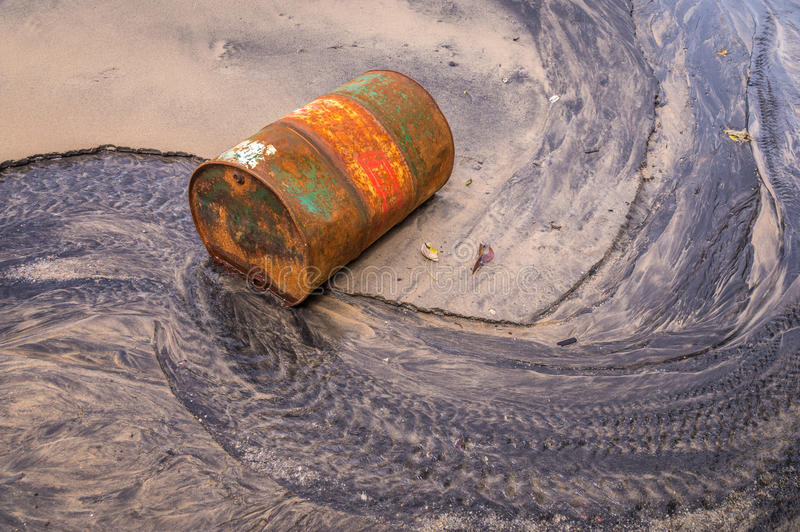 Old rusty barrel oil on beach stock image