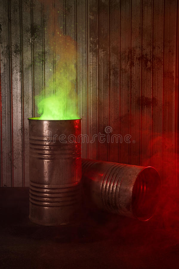 Old rusty barrels with toxic smoke. Biohazard, post-apocalyptic concept royalty free stock photos