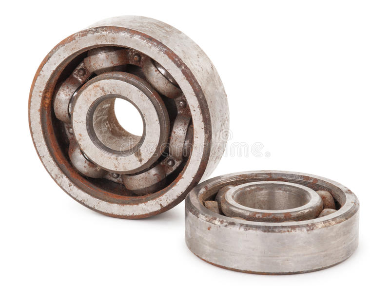 Old rusty bearings. On white background stock image
