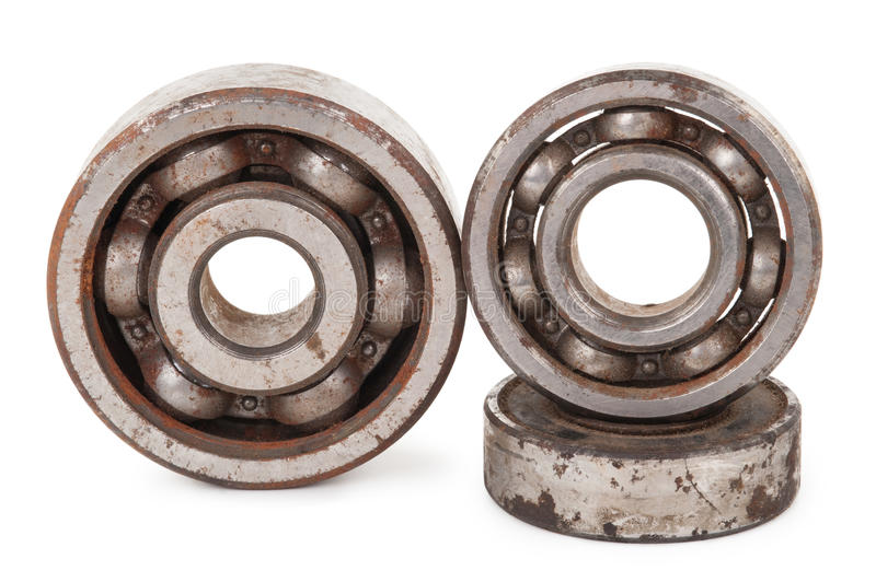 Old rusty bearings. On white background stock photo