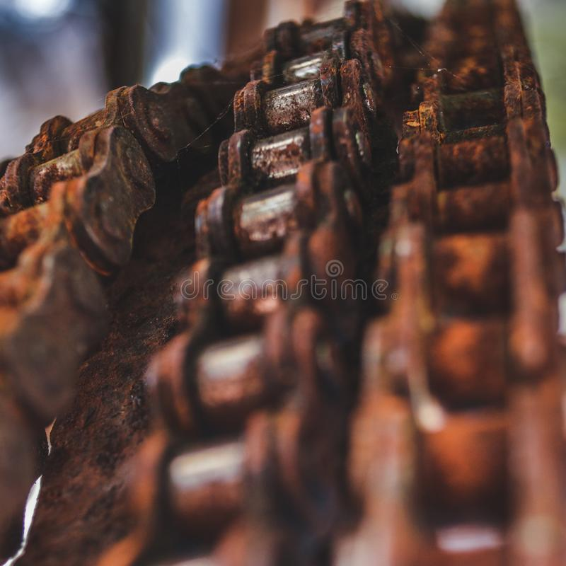 Old and rusty bicycle chains hanging over royalty free stock photo