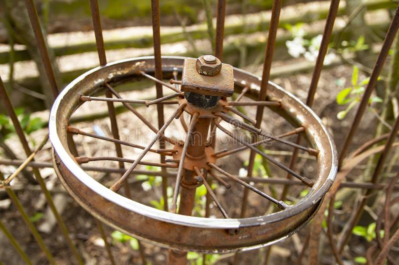 Old rusty bicycle wheel without a tire royalty free stock images