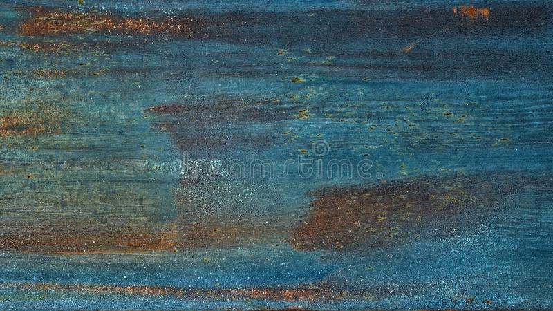 Old rusty blue painted metal texture. Rough metallic surface with traces of rust. Widescreen grunge background royalty free stock photography