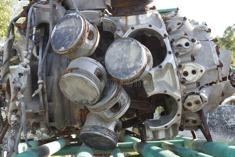 Old rusty broken aircraft engine, piston mechanism stock photo