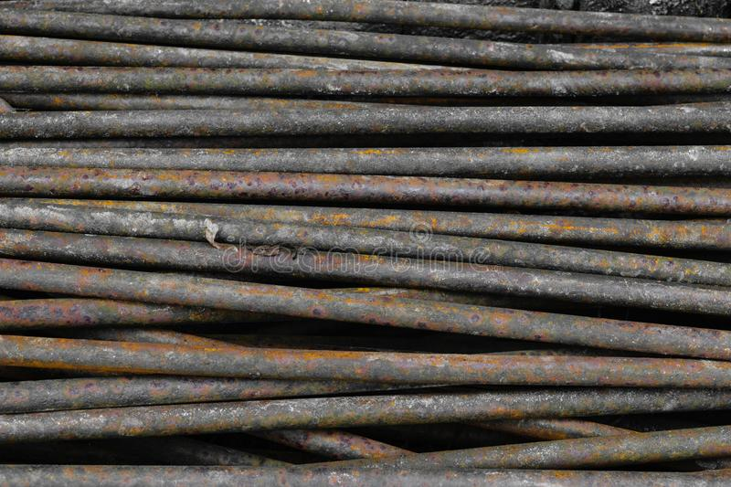 Old, rusty and brown metal rods background surface royalty free stock photos