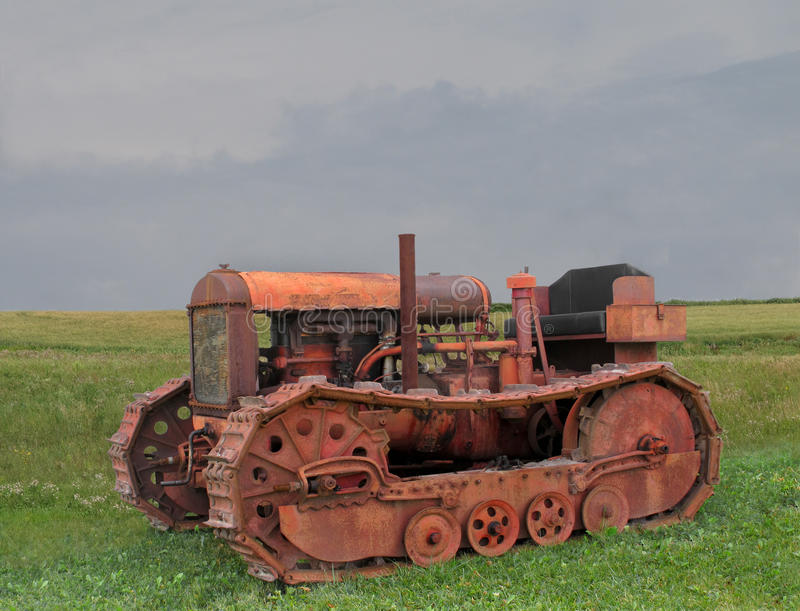 Old rusty bulldozer tractor. Old, rusty, and weathered bulldozer tractor sitting in a prairie field stock photos
