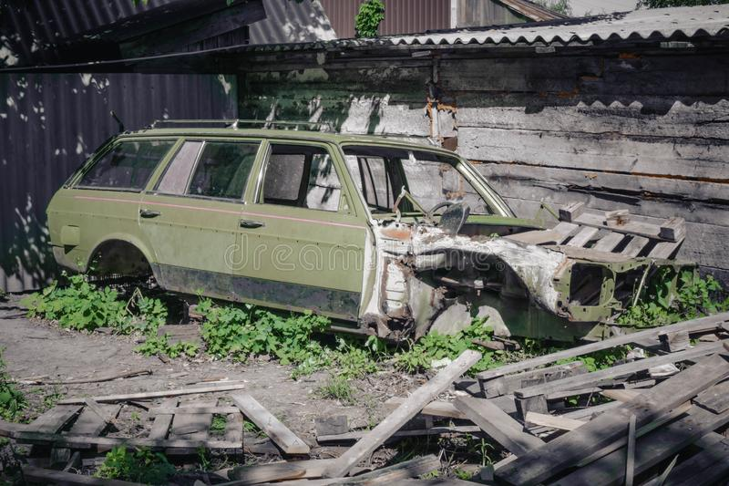 Old rusty car. An old discarded rusted out scrap car that has been abandoned stock photo