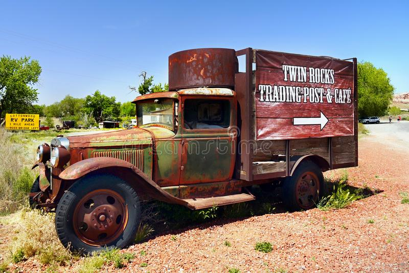 Old Rusty Car. Old rusty vintage car with advert - Twin Rocks Trading Post and Cafe, located in Bluff, Utah royalty free stock photography