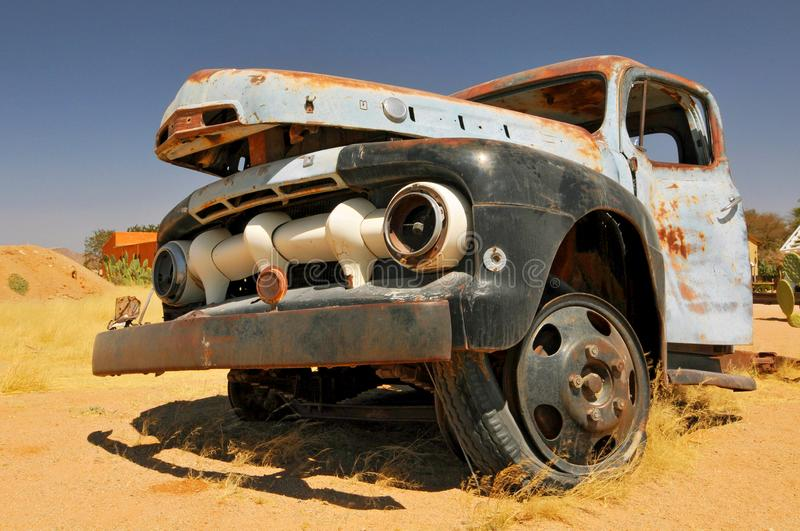 Old and rusty car wreck at the last gas station before the Namib desert. Solitaire, Namibia royalty free stock images
