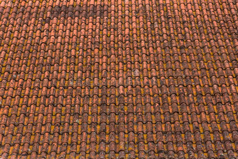 Old and rusty ceramic orange roof tiles texture. View of a old and rusty ceramic orange roof tiles texture line traditional grunge pottery striped frame up stock photos