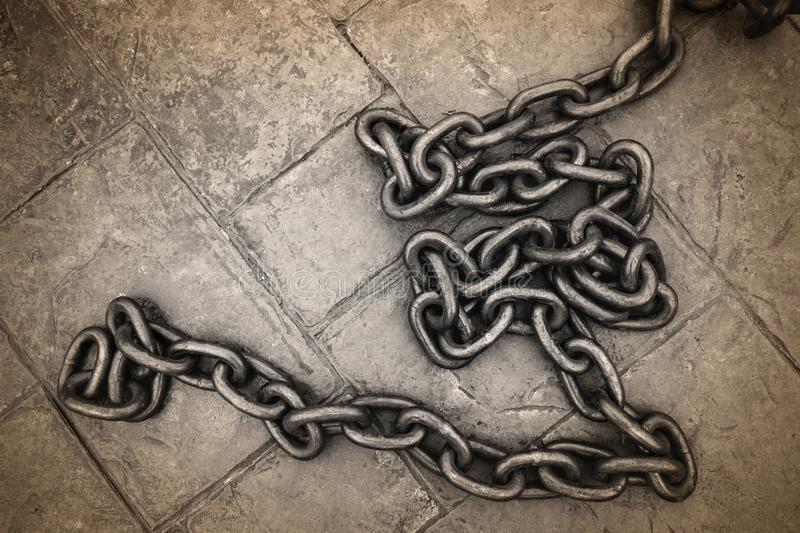 Old rusty chain on concrete floor background.  royalty free stock image