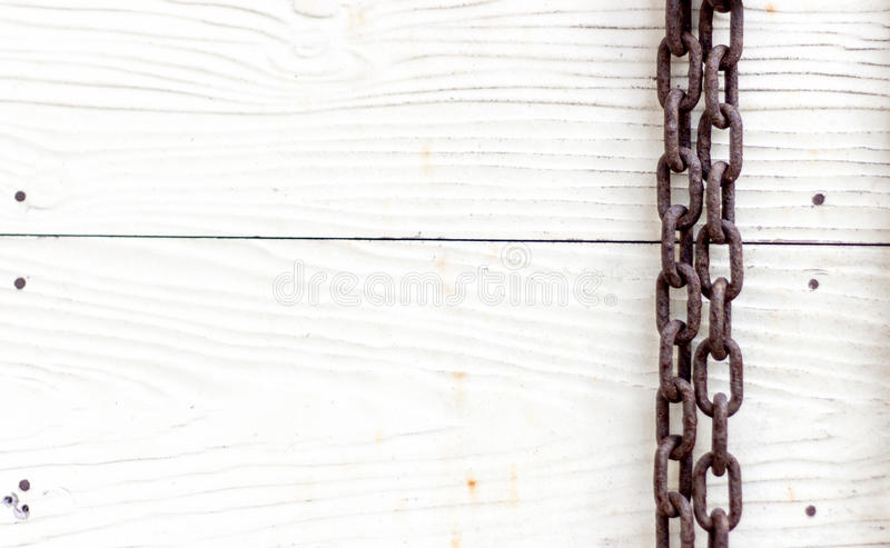 Old rusty chain with wood background royalty free stock image