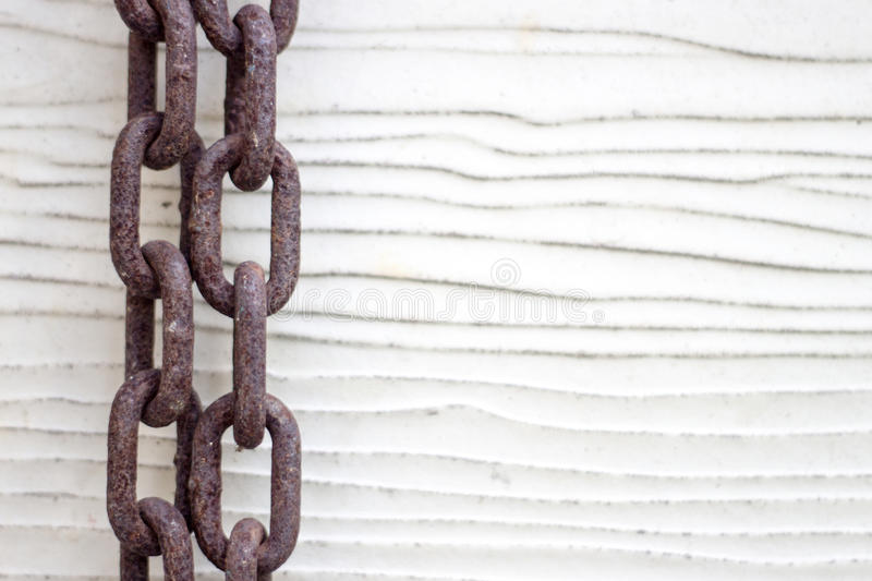 Old rusty chain with wood background stock photo