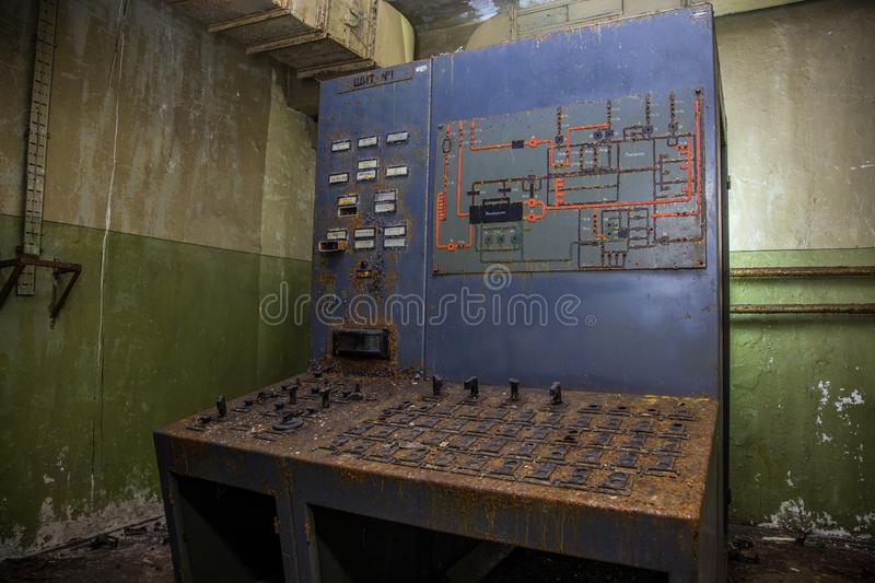 Old rusty control panel in old underground military bunker.  stock image