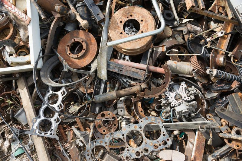 Old rusty corroded car parts in car scrapyard. Car recycling.Wrecking Machinery Parts wait for reused or to be a part for repair royalty free stock photos