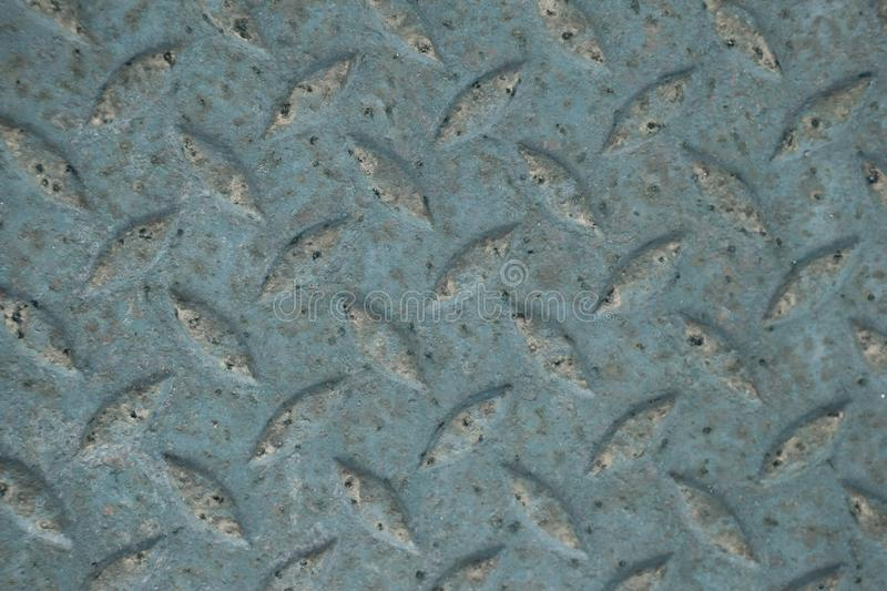 Old rusty diamond metal plate texture pattern used as abstract b. Old rusty green diamond metal plate texture pattern used as abstract background royalty free stock image