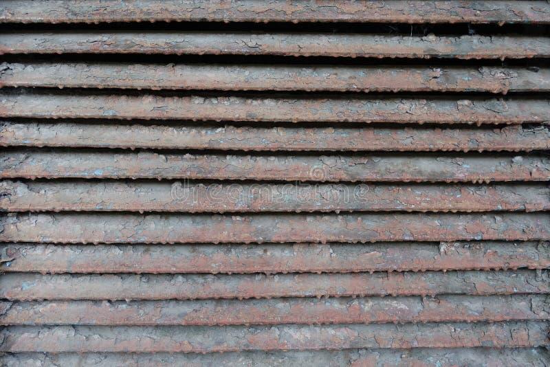 Old rusty dirty peeled metallic slats. Old rusty dirty peeled horizontal metallic slats royalty free stock photos