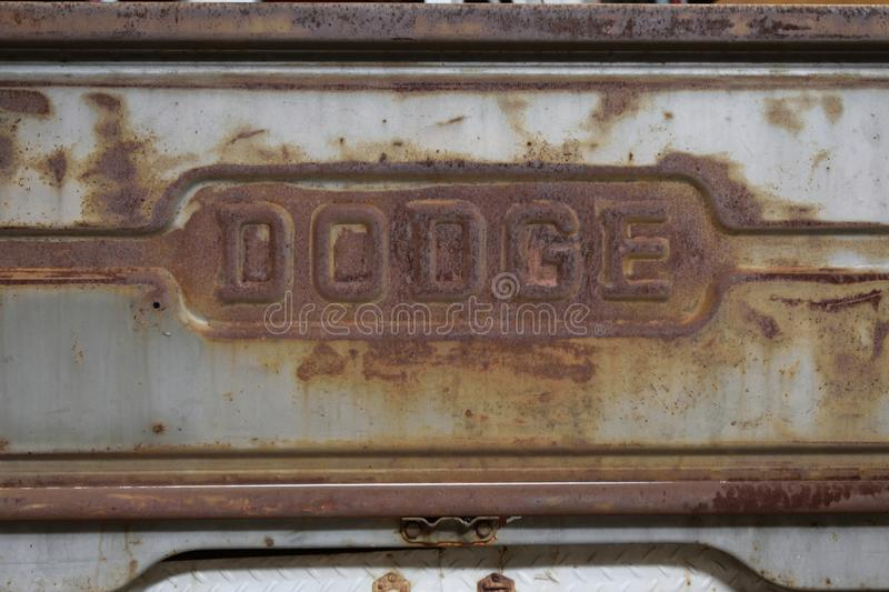 Old rusty `Dodge` emblem on a pickup truck. WARSAW, POLAND - APRIL 07, 2019: Old rusty `Dodge` emblem on a pickup truck. Annual sale of vintage cars in Global royalty free stock photography