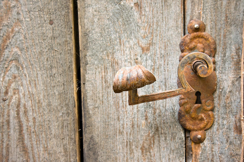 Old rusty doorknob royalty free stock image