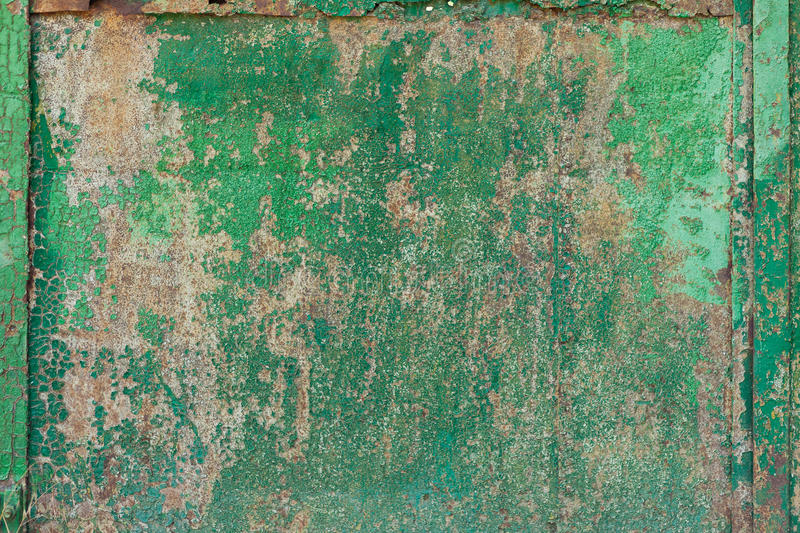 Old rusty doors with green paint. Background stock photo