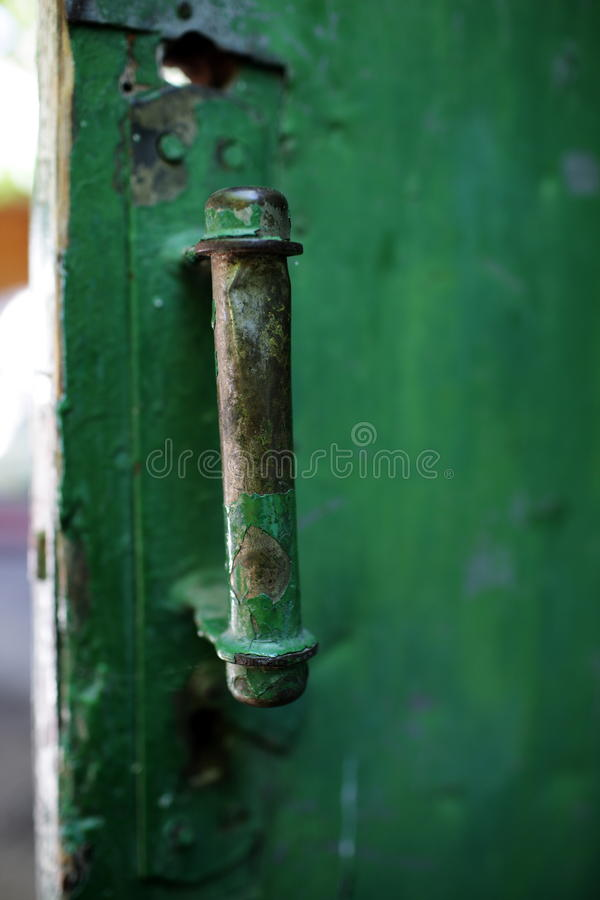 Old rusty doors. Rubbed time stock image