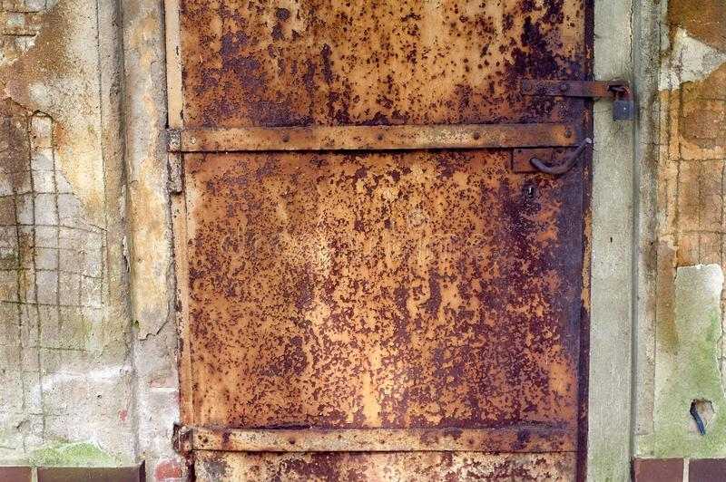 Old and rusty doors texture. Rusty doors texture; Focus on key hole stock photos