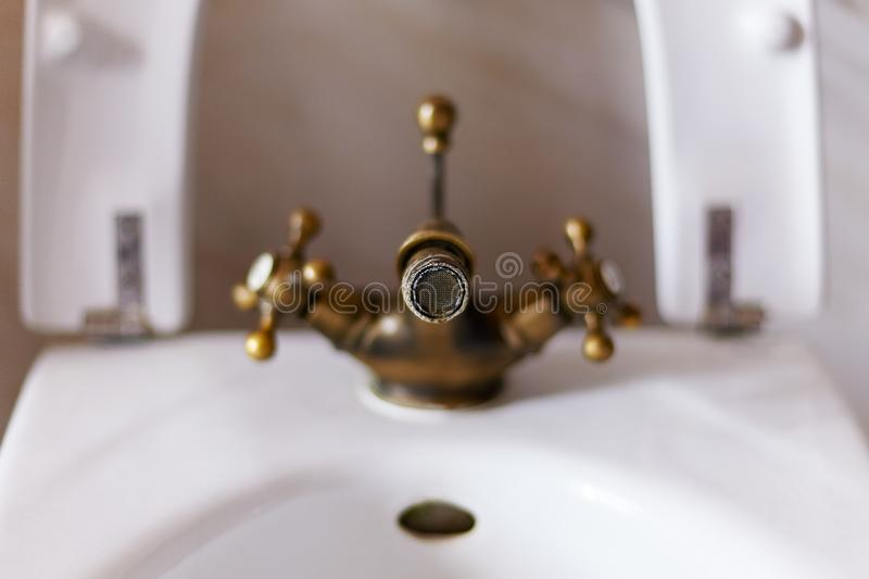 Old rusty faucet aerator with lime spots,. Close-up, light background, indoors, copy space stock photos