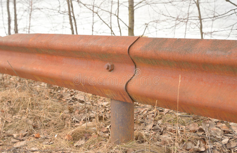 Old rusty fence. The photo of rusty old iron fence close up stock image