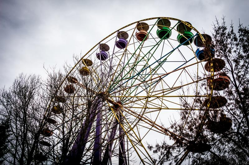 Old Ferris Wheel in dendro park, Kropyvnytskyi, Ukraine. An old rusty Ferris Wheel is one of the attractions in amusement park in Kropyvnytskyi Kirovograd royalty free stock photo