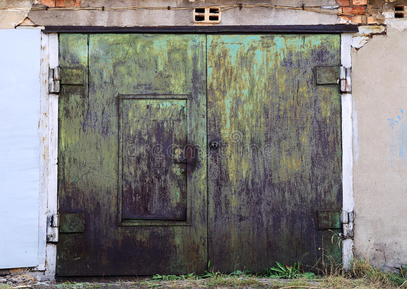 Old Rusty Garage Doors Closed Royalty Free Stock Photos