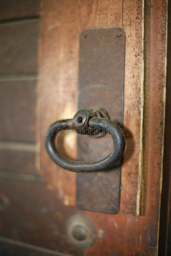 Old rusty gate latch on the door stock photo