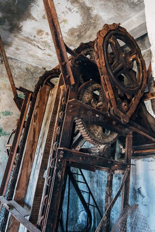 Old rusty gears and chain drive of broken conveyor mechanism.  stock photos