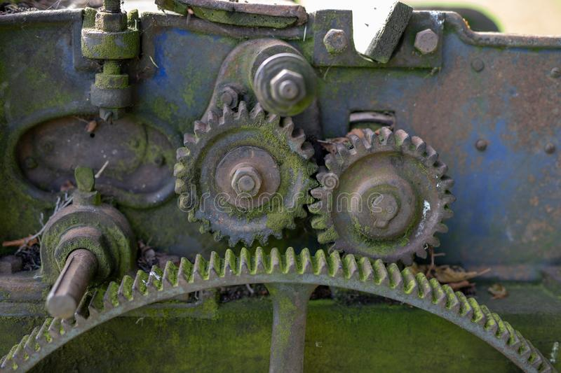 Old rusty gears. Gear wheels in agricultural equipment. royalty free stock images